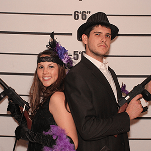 Austin Murder Mystery party guests pose for mugshots